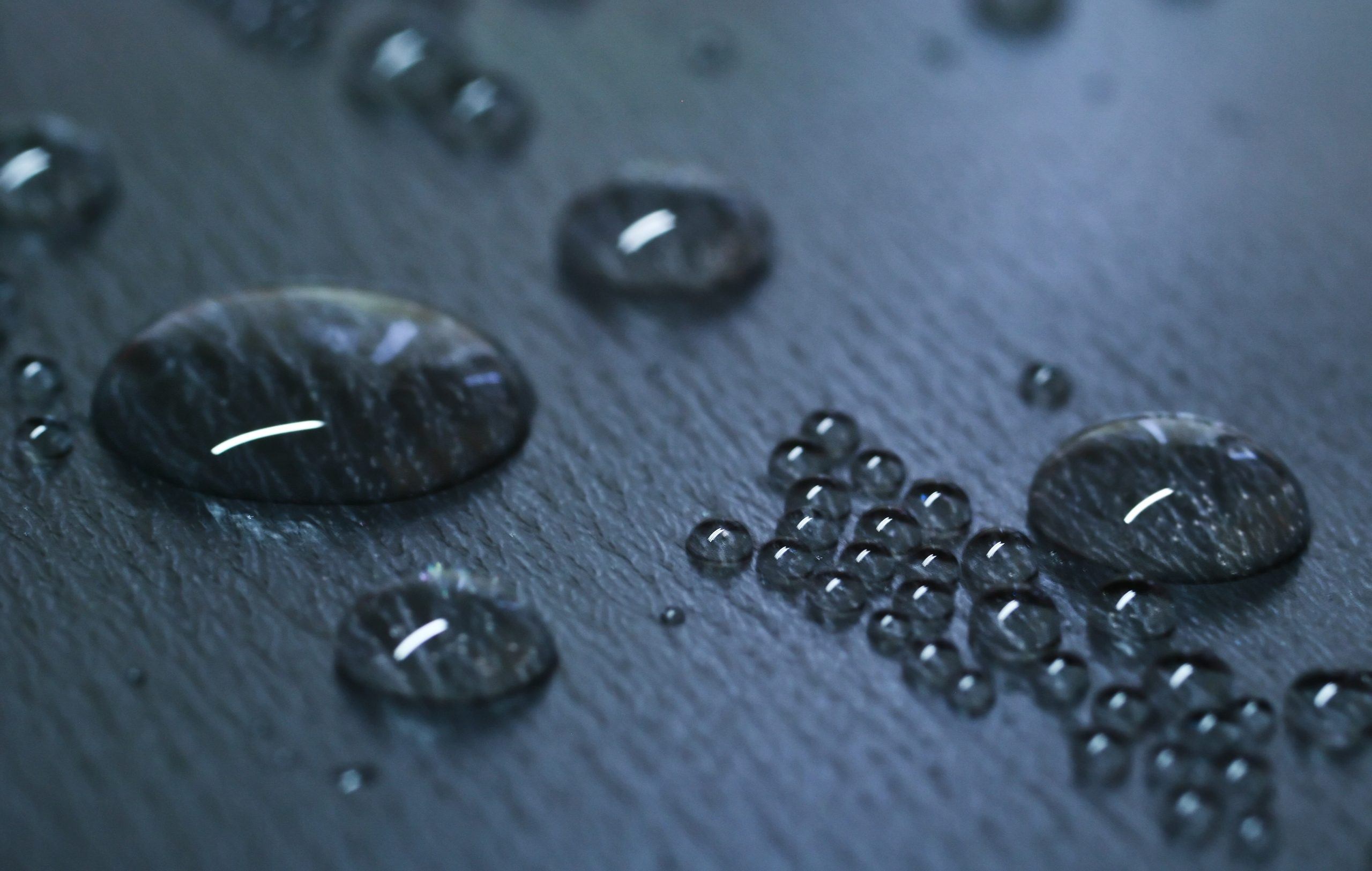 Water droplets beading on hydrophobic coated surface