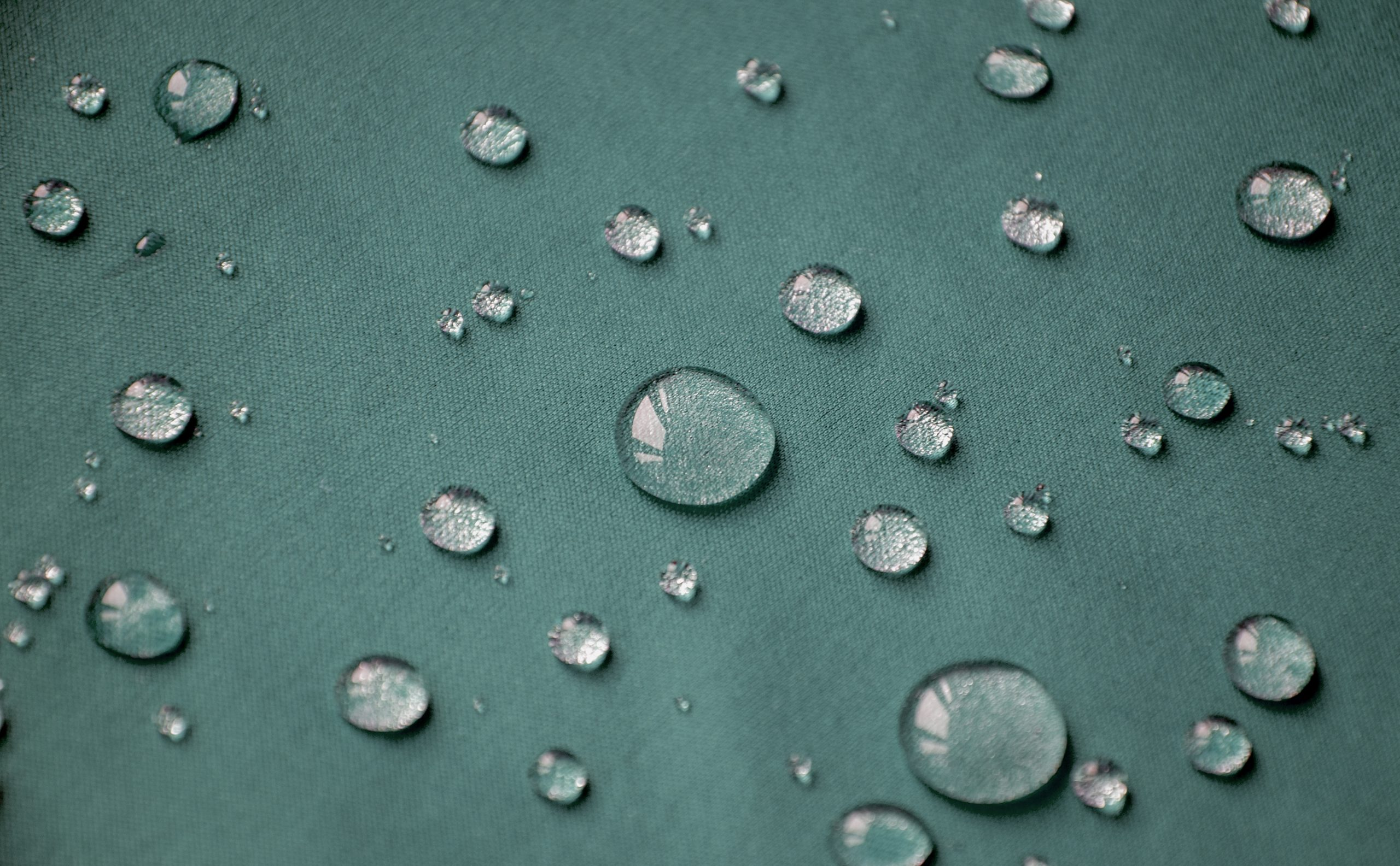 Water beading and repelled by hydrophobic surface treatment
