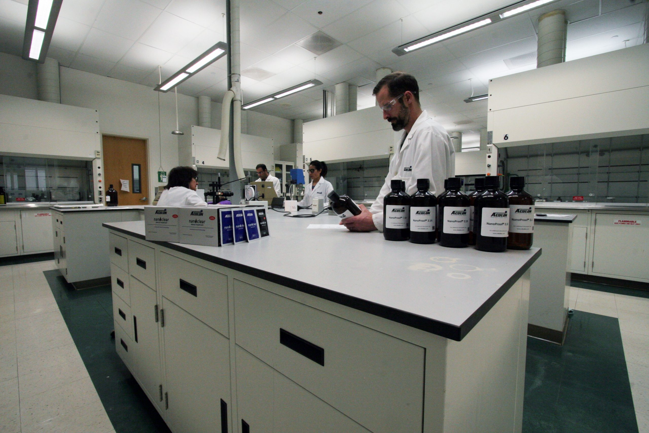 Man working on products in the Aculon San Diego lab