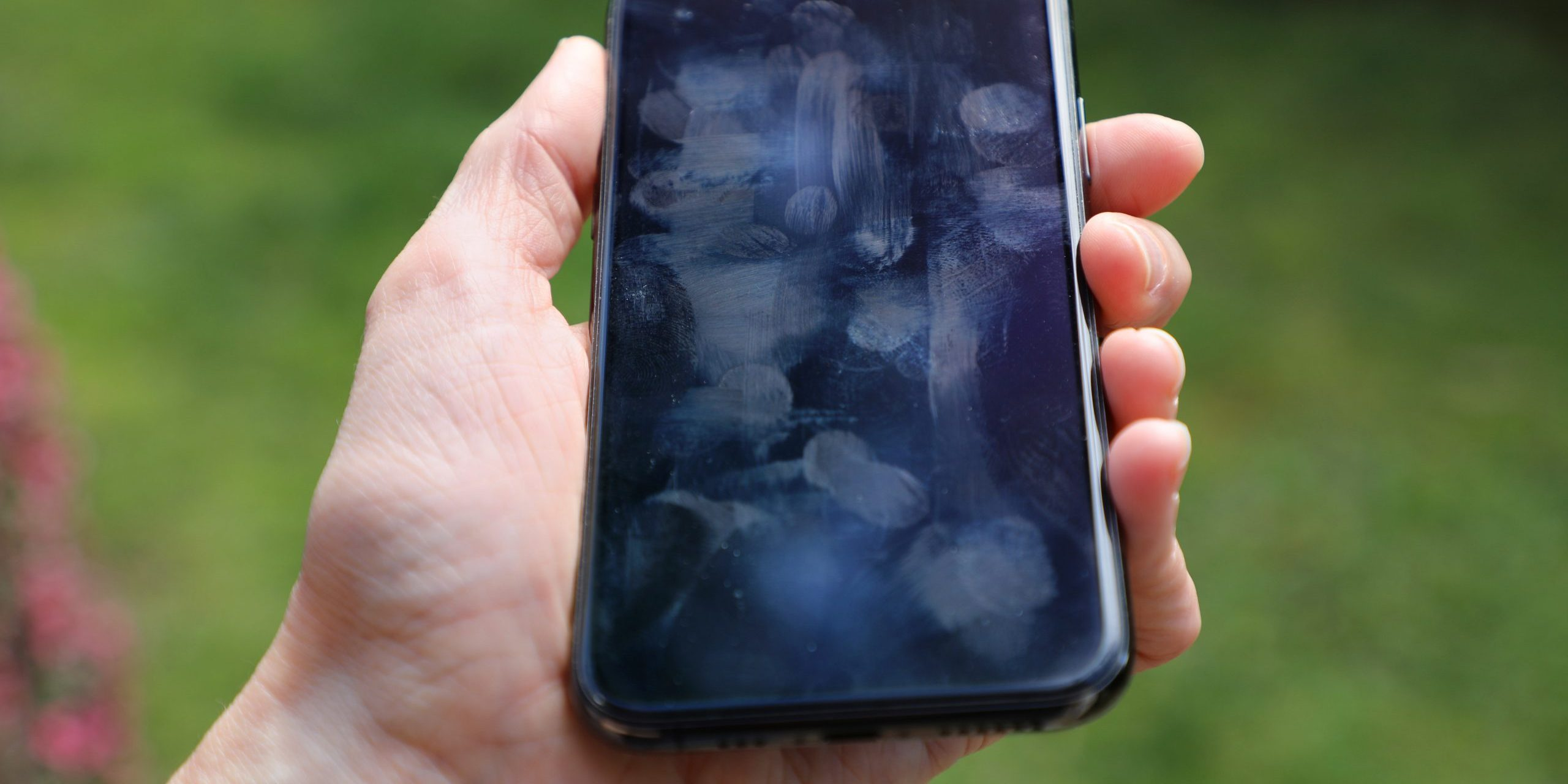 Dirty phone screen with fingerprints and smudges
